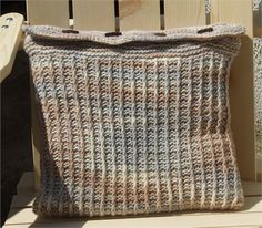 Lovely soft pillow cover knitted in a cream, beige and grey colour with 4brown wooden toggle buttons Washable at 30 deg C - 100% eco wool Size 16 x 16 ( 40cm x 40cm) will stretch slightly **Cushion insert is NOT included**    Please note : Colours may appear differently on some monitors.    Please readshop policies before purchase