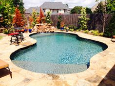 Simple, but beautiful Concrete Pool with Sun Ledge and Rock Waterfall