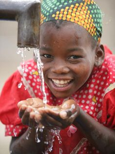 Providing communities with safe drinking water ensures girls – who sometimes have to walk for hours each day to collect water for their families – go to school instead. © UNICEF/NYHQ2006-2251/Pirozzi