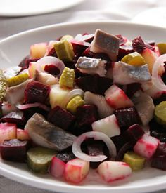 This tasty herring salad features beetroot, which boosts both the color and the flavor of the dish. This unusual appetizer will add a splash of color to your buffet table and the way the fish goes with the piquant flavors from the pickles, onions and other ingredients is wonderful. You might like to add some chopped chilies or hot sauce for a spicier finish.