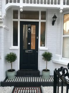 Victorian tiles and Farrow&Ball front door in SW London Elegant stylish front door and garden in SW London Front door in Farrow and Ball Railings Victorian tile path and steps from Mosaics by Post, UK. Trees and pots from Neals Nursery, Earlsfield Front Door Steps, Front Door Porch, Porch Steps, Front Door Entrance, House Front Door, House With Porch, Victorian Front Doors, Victorian Porch, Victorian Townhouse