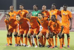 Members of the Umm Salal football team form a huddle prior to the start of their Qatar Stars League match in Doha
