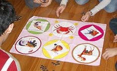 "The game bầu cua cá cọp (bầu cua cá cọp ""squash-crab-fish-tiger"") is a Vietnamese gambling game using three dice"