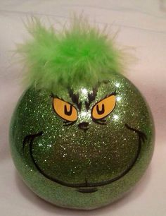 Dr Seuss the grinch Christmas holiday glitter ball - take a clear ball, add liquid floor cleaner and roll around to cover entire surface. Shake out excess. pour in green glitter and cover every inch of inside. Dry and then paint the face on with paints or permanent marker.