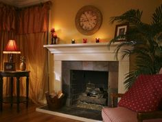 A dated fireplace is dressed up with molding and slate tiles.