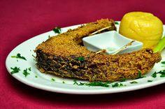 ... fish... in stil traditional (alaturi de usturoi si mamaliguta)..