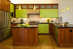 Green Craftsman Kitchen - The door style is traditional but the green color scheme offers a bold, fun and modern twist! Dura Supreme Cabinetry designed by Barbara Bright Design.