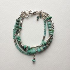 Green Matrix Jasper, Turquoise, Apatite, and Hill Tribe Sterling Silver Triple Strand Bracelet. $88.00, via Etsy.