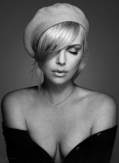 Charlize Theron, love love the hat/hair/makeup!  I want to copy that look, minus the cleavage, Lol. Couldn't get way with that in real life.