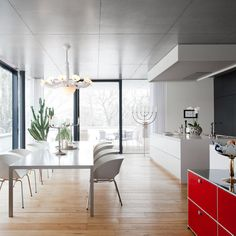 The kitchen is located in an open-plan living area, the room offers generous seating as well as plenty of space to stand and circulate, with a large island bridging the kitchen and dining areas