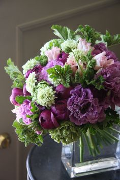 Flower Arrangement in purple white and green with ranunculus,eustoma,tulip and scabiosa