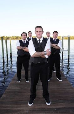 Groomsmen - reception wardrobe - red vest & tie with converse, sleeves rolled up