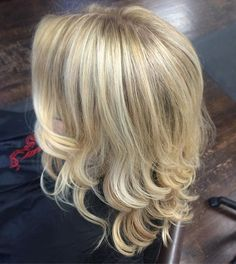 Blonde highlights lowlights balayage layered haircut with beach waves