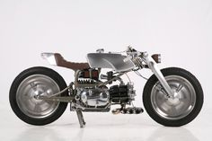 "The 2013 AMD World Championship title has just been won by Medaza Cycles' ""Rondine"". A one-off frame carries a single-cylinder, 1971 Moto Guzzi Nuovo Falcone 500 engine."