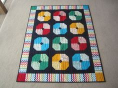 My 3rd Quilt - Bold Colours using Lucie Summer's fabrics.  A birth present for Zac's little brother Noah.