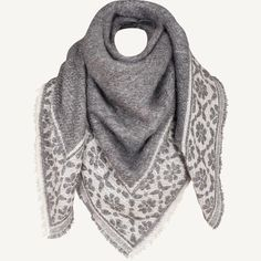 This square shaped scarf has a lovely amount of wool in the fabric to make it really fluffy, and it's super soft for comfort and a great weight to layer over your favourite jumper or coat.
