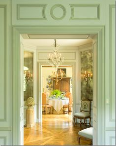 Green boiserie in one room and cream in room beyond; octagonal entry walls? Venetian plaster? could use toile, too.  Love the Louis IV chairs
