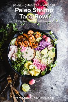 This Paleo Shrimp Taco Bowl with Cilantro Lime Cauliflower Rice brings you all the best flavors of a shrimp taco in an easy deconstructed bowl. It's loaded with veggies, gluten-free, and Whole30 friendly, plus it comes with lots of options to customize it. | StupidEasyPaleo.com #glutenfree #grainfree #paleo #paleorecipes #shrimp #tacos #whole30 #whole30recipes via @Stupid Easy Paleo