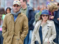 Off-camera pals Jon Hamm and Elisabeth Moss hit the streets of New York in colorful wayfarer sunnies! Translucent yellow shades for him and cherry red sunnies for her!