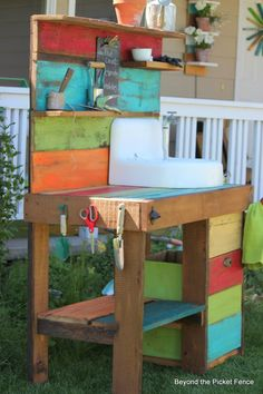 Colourful reclaimed wood potting bench with a vintage sink... clever! By Beyond the Picket Fence