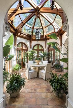 I would love a room like this...lots of plants, table, chair, hammock, sun - mmmmmmmmm