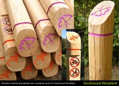 Colourful timber waymarkers, different symbols represent different trails © Eleventh Hour Design