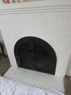 Make your Arched Fireplace look elegant with custom made Fireplace Doors