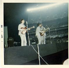 The Beatles performing at Shea Stadium , 23rd August 1965