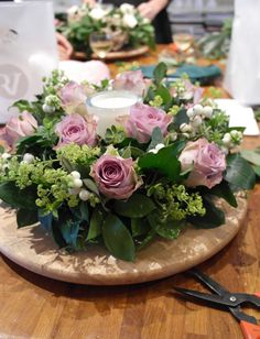 Welcoming candle and flower table wreath by Judith Blacklock
