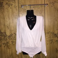 Arden B. Onesie Beautiful off white ARDEN B. TUTU Top Size EXTRA SMALL ~ does stretch nicely!  Used condition, minimum peeling to the back! ( Polyester, rayon & spandex material ) Plunging v- neckline, sheer sleeves they have slits on both arms *captured in 4th photo* snap closure on the bottom as a onesie does. \\ SUPER CUTE!  Arden B Tops
