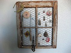 window with chicken wire to hang jewelry from.