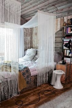 Fringe and whitewash walls. Just lovely. I've always liked the idea of a canopy like this...