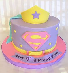 Create a memorable superhero party for your caped crusader with this amazing supergirl cake. Pink Superhero party food and cake inspiration to compliment to the Bee Box Parties Superhero Collection.