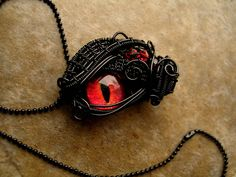 Custom - Black Wire Wrapped - Fire Dragon Eye by LadyPirotessa on DeviantArt