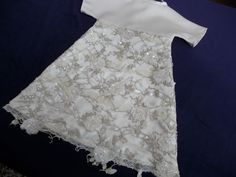 Angel gown with heavily embellished fabric.