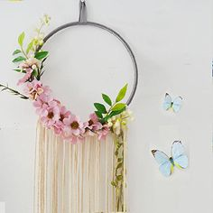 Look at this beautiful handmade Large Tassel Dream Catcher with flowers. Would give a nice bohemian touch to your kid's nursery.