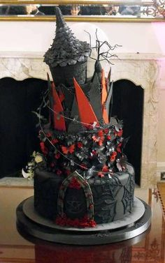 awesome Goth black castle cake via Courtney Castrey.