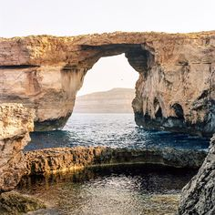 "The Azure Window in Gozo, Malta, of ""Game of Thrones"" fame, collapsed two weeks ago. @markwickens got to see the arch both before it was popular with tourists and before it fell down. . ""On the western edge of the island, with water so blue and rock so yellow, it was a solitary place that prompted self-reflection. The Azure Window was there long before we were, and, because of time and erosion and the natural progression of the landscape of the island, it fell. Sadly, that's just the way…"