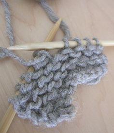 Julia Marsh Trial knitting handspun grey suffolk yarn  single ply knitted test piece.