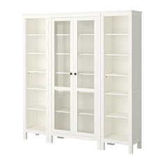 HEMNES Storage combination - white - IKEA $580; or there's a 3-column piece with all glass front doors for the same price