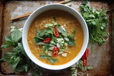 Spicy Thai Curry Noodle Soup Recipe Soups with garlic cloves, fresh ginger, red curry paste, coconut oil, vegetable broth, coconut milk, rice sticks, fresh cilantro, green onions, thai basil, red chili peppers