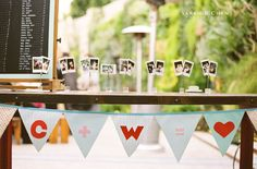 Include hanging photos, left side seating arrangements, right side card box, hanging banner, center wedding favors?