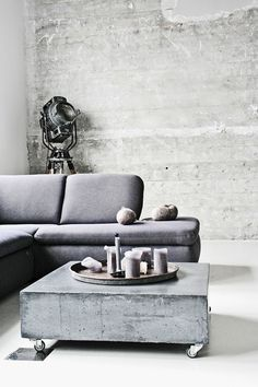 PIN 3: This industrial roller coffee table is made of what looks like one large concrete slab. It is practical and would suit any modern home. The room has been done up in light grey and white tones, making the coffee table a significant feature.