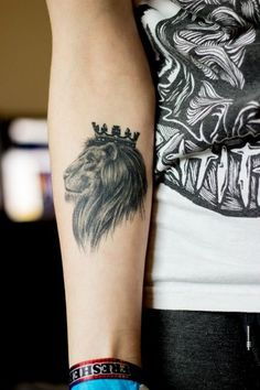Forearm Tattoo Ideas and Designs 55- Lion Tattoo with crown
