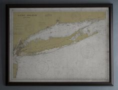 A fine art quality vintage reproduction of an early 19th Century nautical map of Montauk Point, New York. These finely detailed maps are still used today as essential tools by mariners; providing scientific data on charting coast lines and interior bodies of water. This piece not only provides nautical facts and information, it displays the natural contours of the coastline. The visual impact of the piece emphasizes the beauty of where the lands meets the sea.  Please note, frames are not…