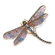ART NOUVEAU PLIQUE-À-JOUR ENAMEL AND DIAMOND DRAGONFLY BROOCH, CIRCA 1900. The wings of pale lavender and turquoise plique-à-jour enamel edged in single-cut diamonds, the body set with old-mine and single-cut diamonds, the eyes of green chalcedony, mounted in gold and silver, pin stem stamped 56 GN.