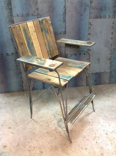 One of the best Director Chairs I've ever sat in by far... 100% recycled #4 rebar steel and white washed pallete wood... It's even made with a drink holder in the armrest...