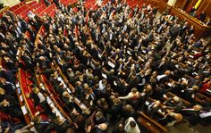Lawmakers vote for different laws after approving the new Ukrainian state budget for 2014, during a session of Parliament in Kiev, Ukraine, ...