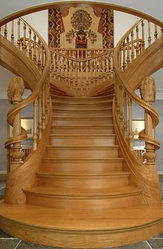I really enjoy this mansion-styled staircase. It becomes a focus point in the center of any home, consisting of luxurious wide steps that fork left and right mid-way up. Extravagant.