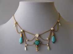 A gold and Persian turquoise festoon and pearl necklace from the Victorian era.